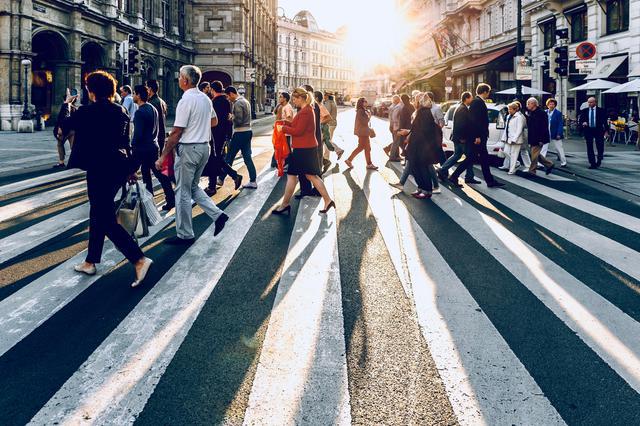 People crossing street in Vienna.