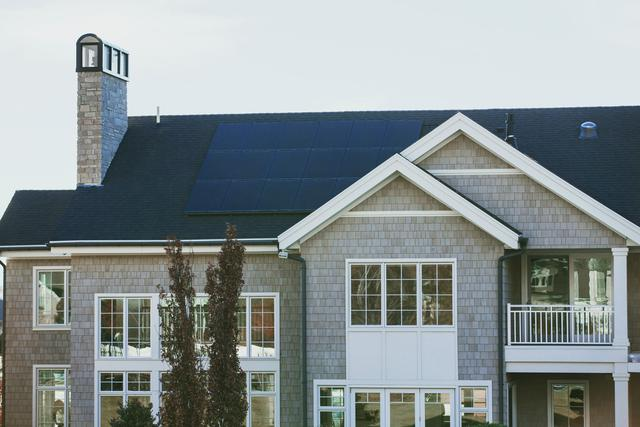 home in Maryland with solar electricity panels on the roof