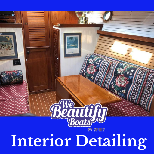 interior of a boat with we beautify boat logo and a word interior detailing.