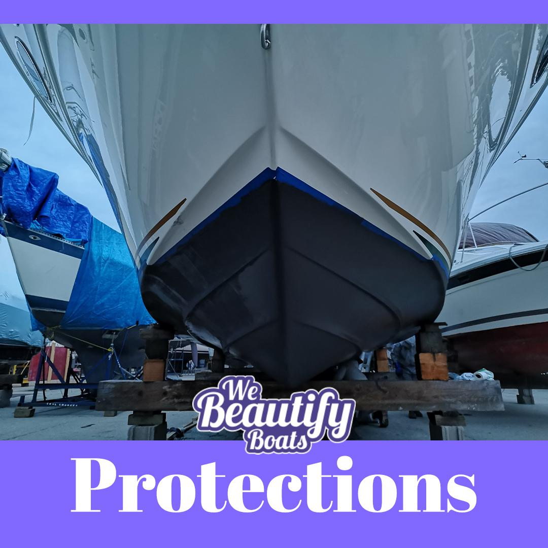 A bottom of a motor boat paint with black antifouling with we beautify boat logo and a word PROTECTION