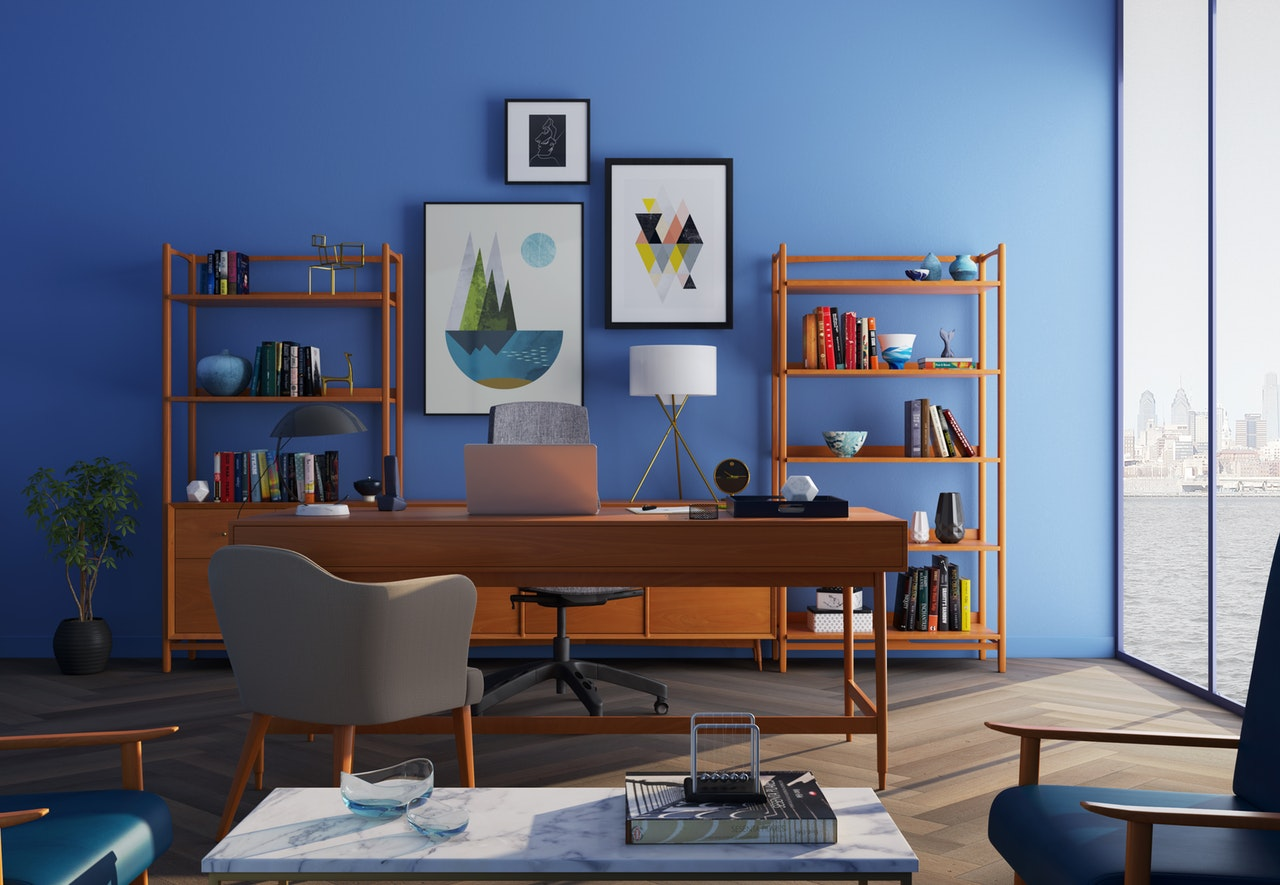 brown-wooden-desk-with-rolling-chair-and-shelves-near-window-667838.jpg