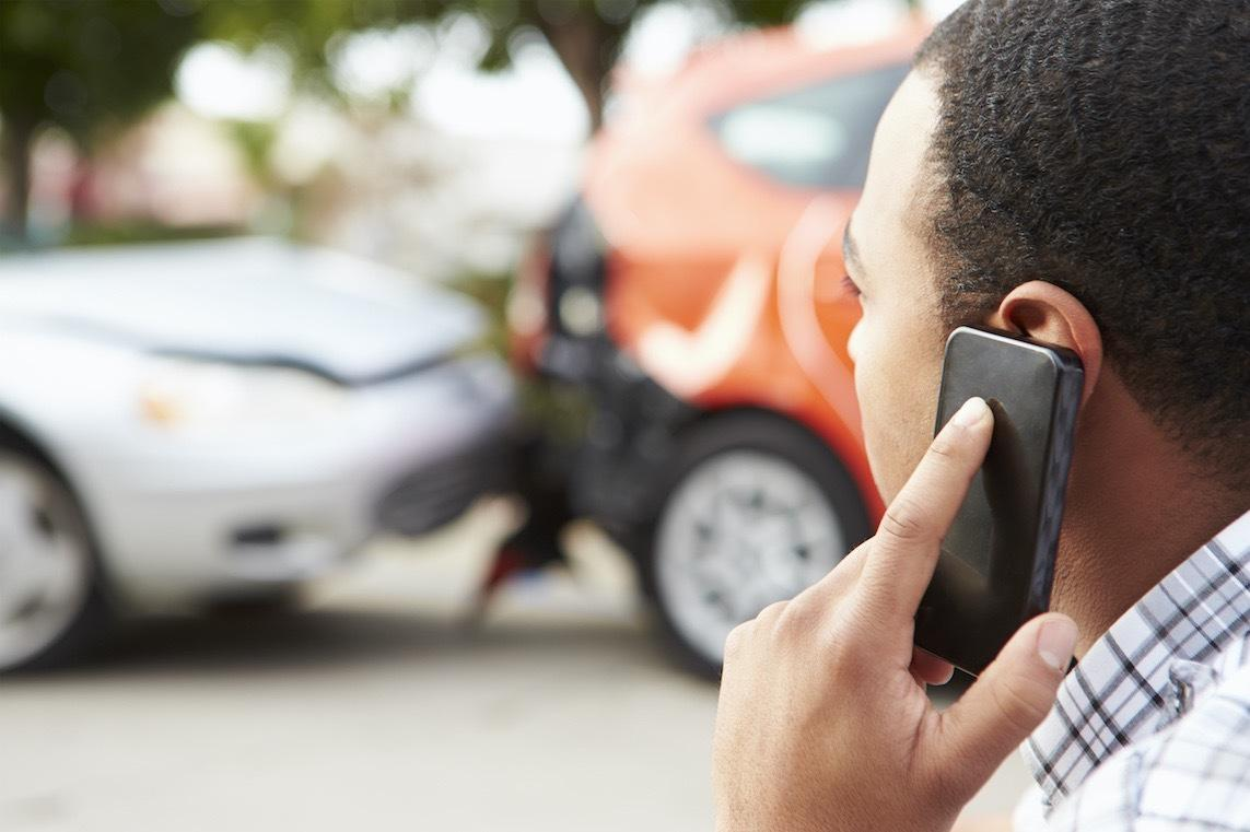 man on the phone after getting into a car accident