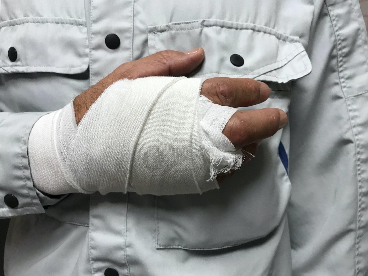 man with a bandaged hand and wrist