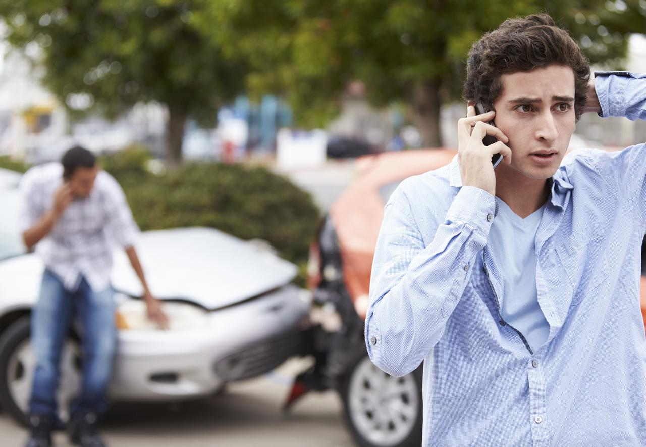 man making a phone call after a car accident