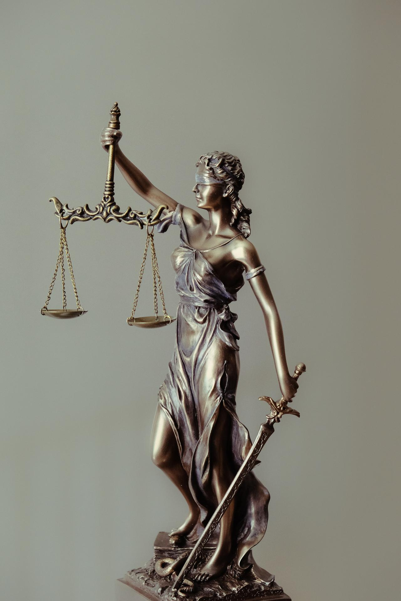 Lady Justice statue at offices of personal injury attorney in Wilmington, NC.