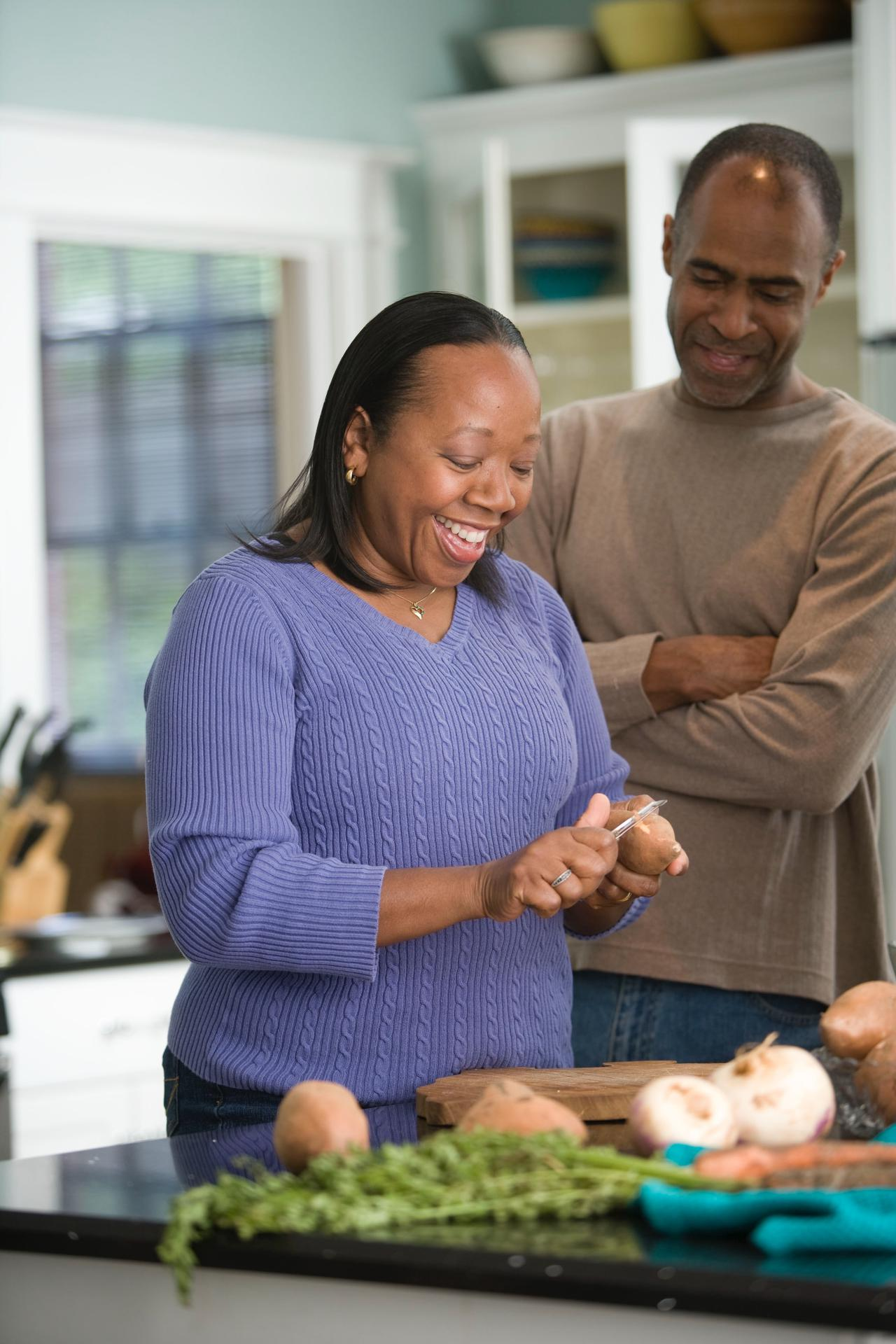African American couple preparing a meal. Photo by Cade Martin