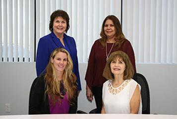 Photo shows South Florida accountants Debbie, Maria, Annette, and Evelyn.