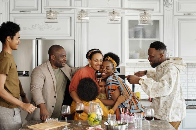 A family celebrating after using Revive Home, Inc.'s home remodeling services in the Bronx and the greater tri-state area.