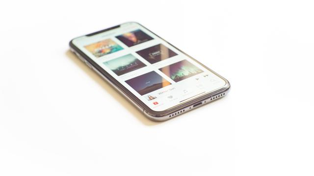 Phone on Desk. This a double image. The image on the iPhone X is also photographed  by me.   Can be seen at https://500px.com/photo/237711251 or at my site h3p.info