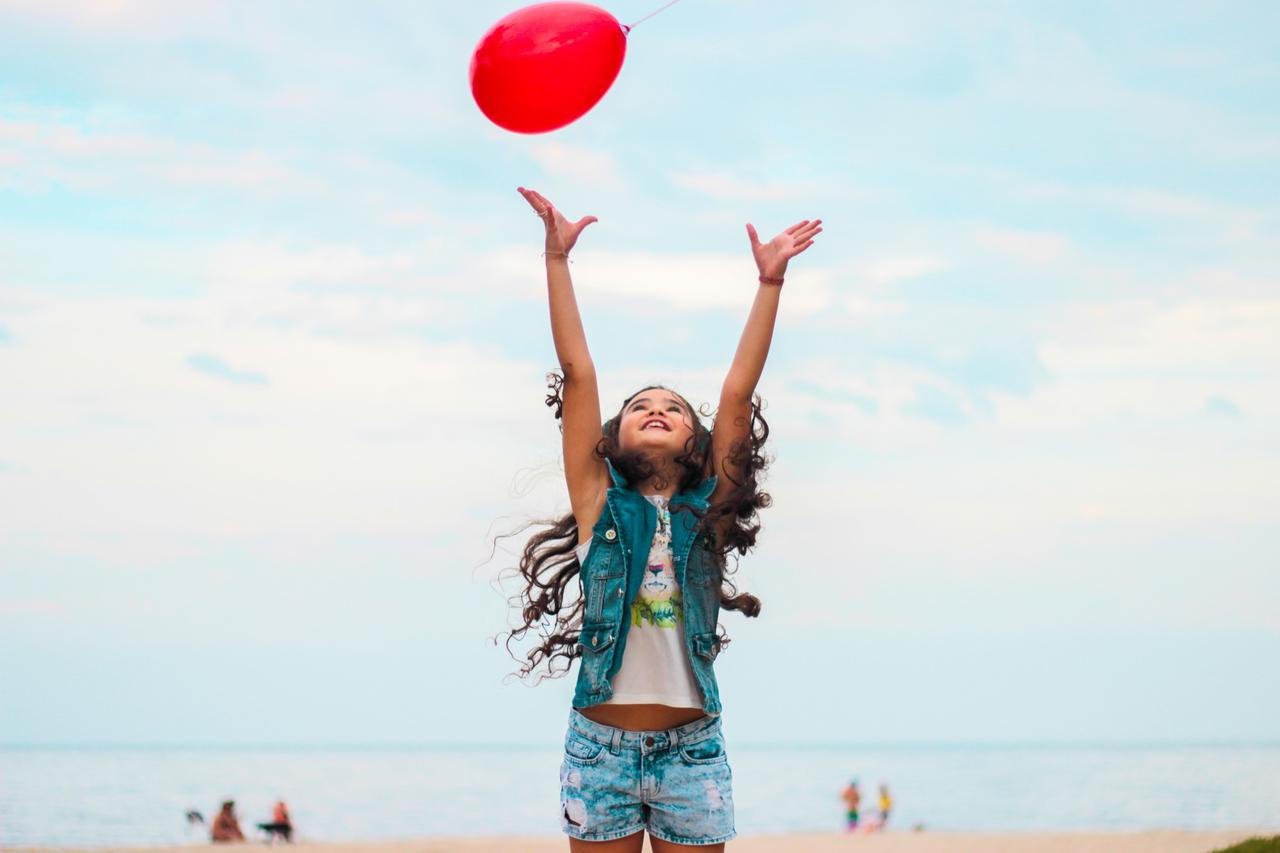 girl raising her hand