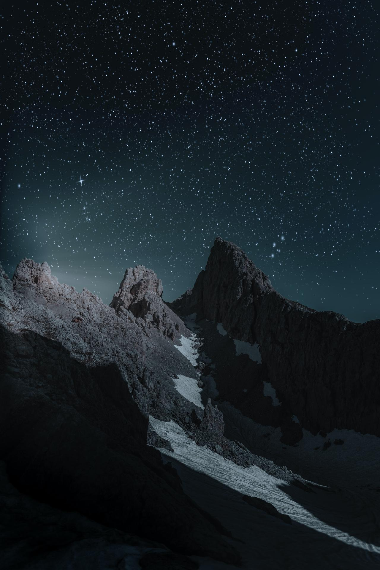 mountain against a starry night sky