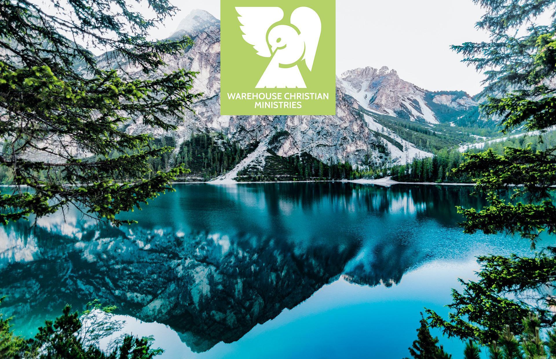 mountain lake with Warehouse Christian Ministries logo