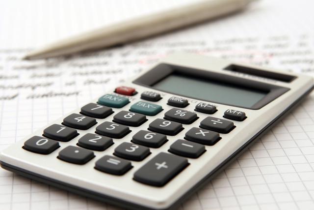 canva - calculator on accounting workspace.jpg