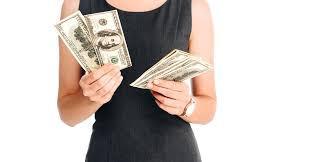 gal holding money.jpeg