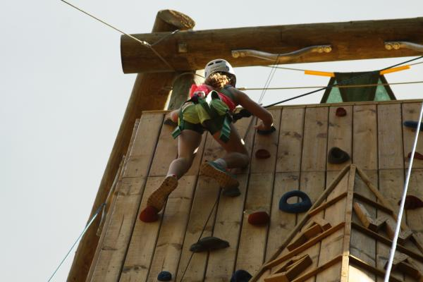 girl climbing tower