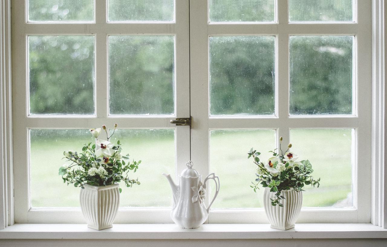 Porcelain teapot on windowsill