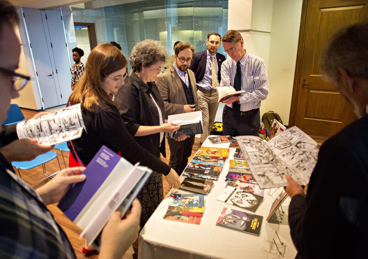 <p>Students check out Chilean comics donated to the James Smith Noel Collection by an organization affiliated with the Chilean government. (Photo by Jessica Ingram)</p>