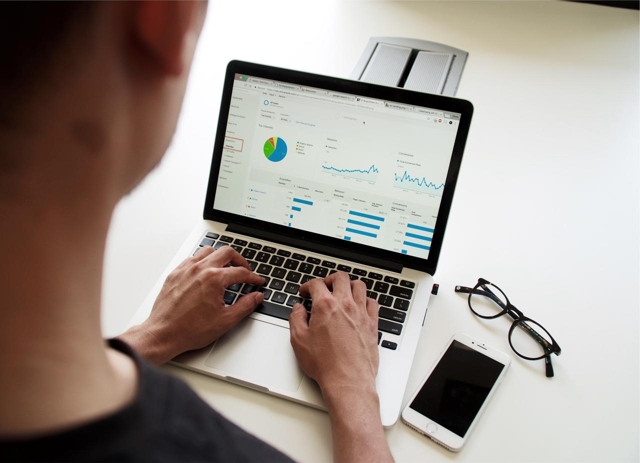 Man reading report of consolidated feedback through customer management software.