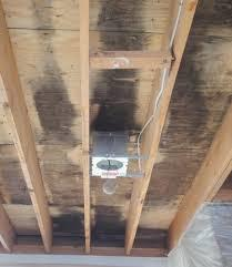 An image of a wooden ceiling with a system installed.