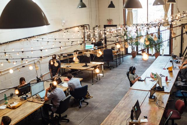 Image of people working in a coworking space getting help from accounting services for small business.