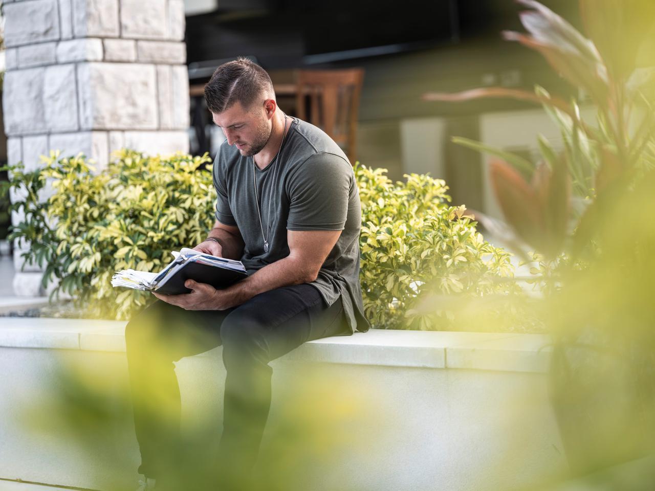 Spending Time in God's Word... Model: Tim Tebow    Photo Credit: Grit Media