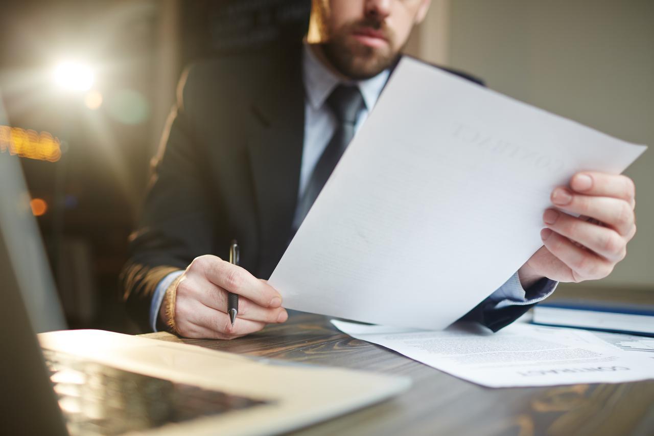 businessman-working-with-documentation-at-desk.jpg