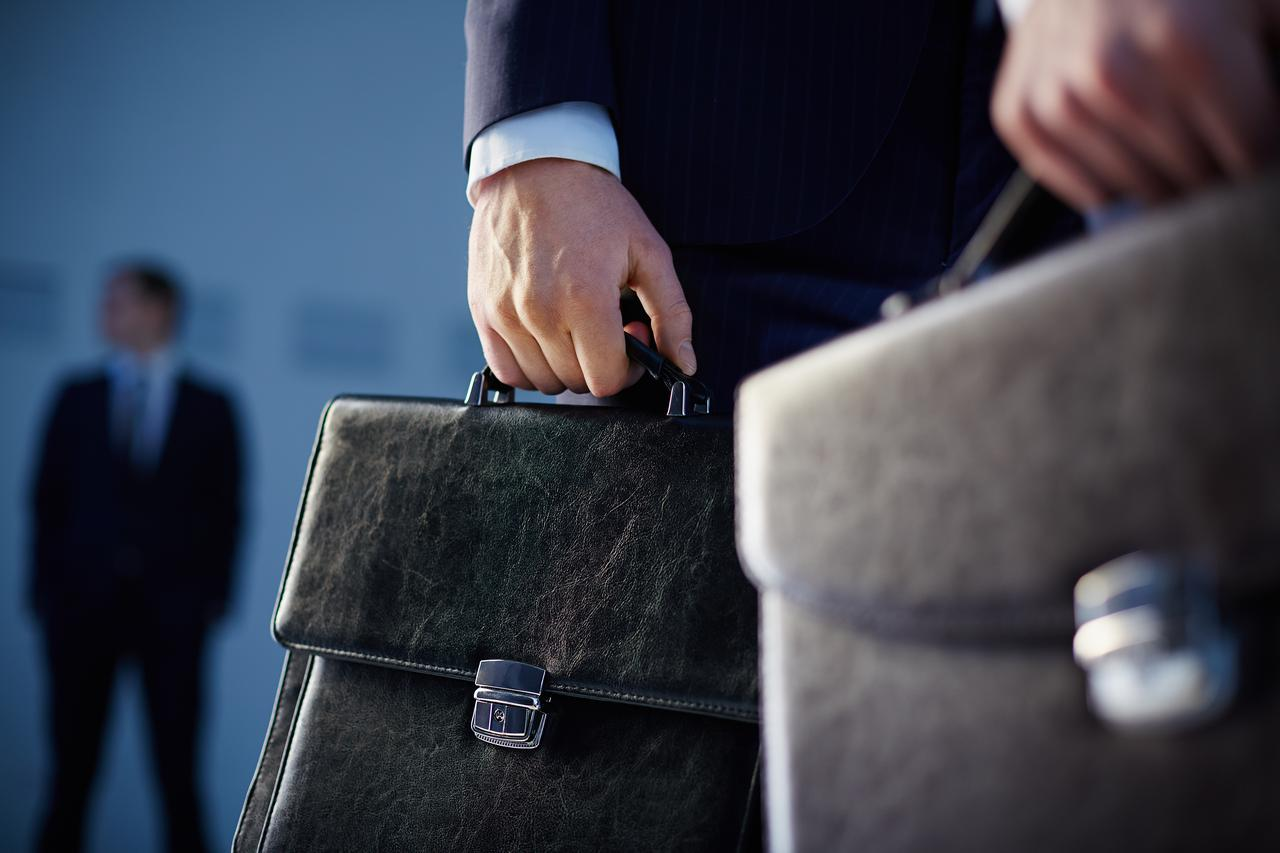 close-up-of-workers-with-briefcases.jpg