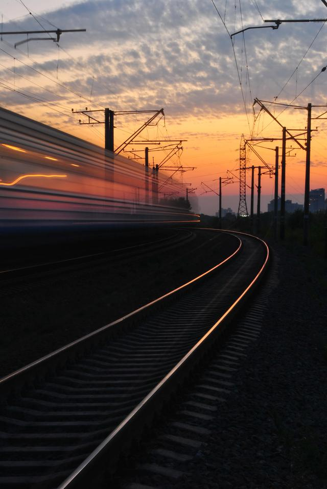 rail-road-under-gray-and-orange-cloudy-sky-during-sunset-163856.jpg