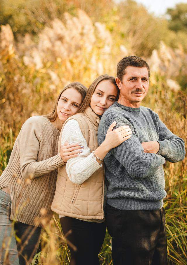 Fatther and his daughters happy together after attending family bonding retreat.