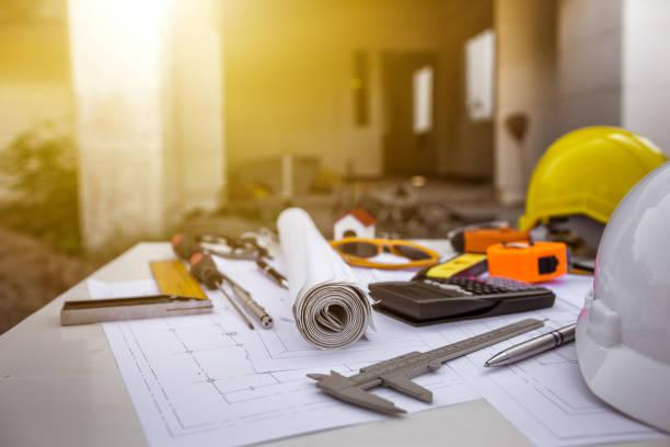 tools and plans on a construction site desk
