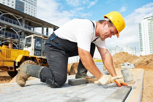 man at a construction site working on a commecial build