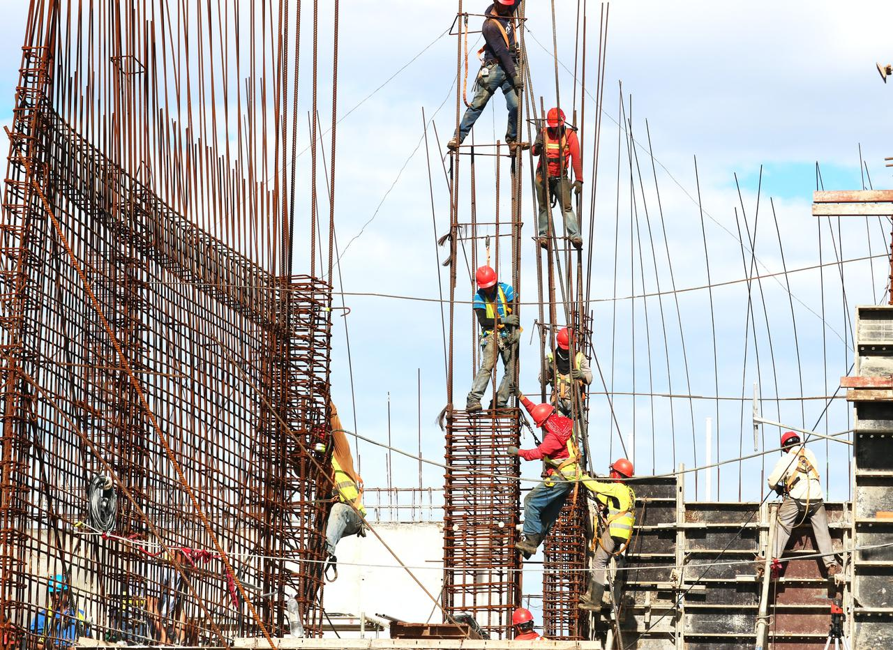 group of construction workers building