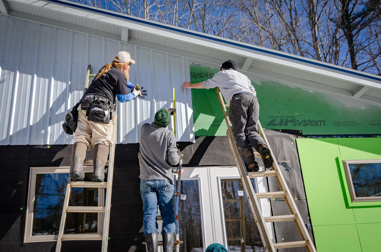 My photos shows some siding contractors working on a new construction in Black Mountain, NC. Don't be fooled by the sunny weather - it was FREEZING that day! :(