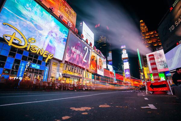 A Disney billboard at night.