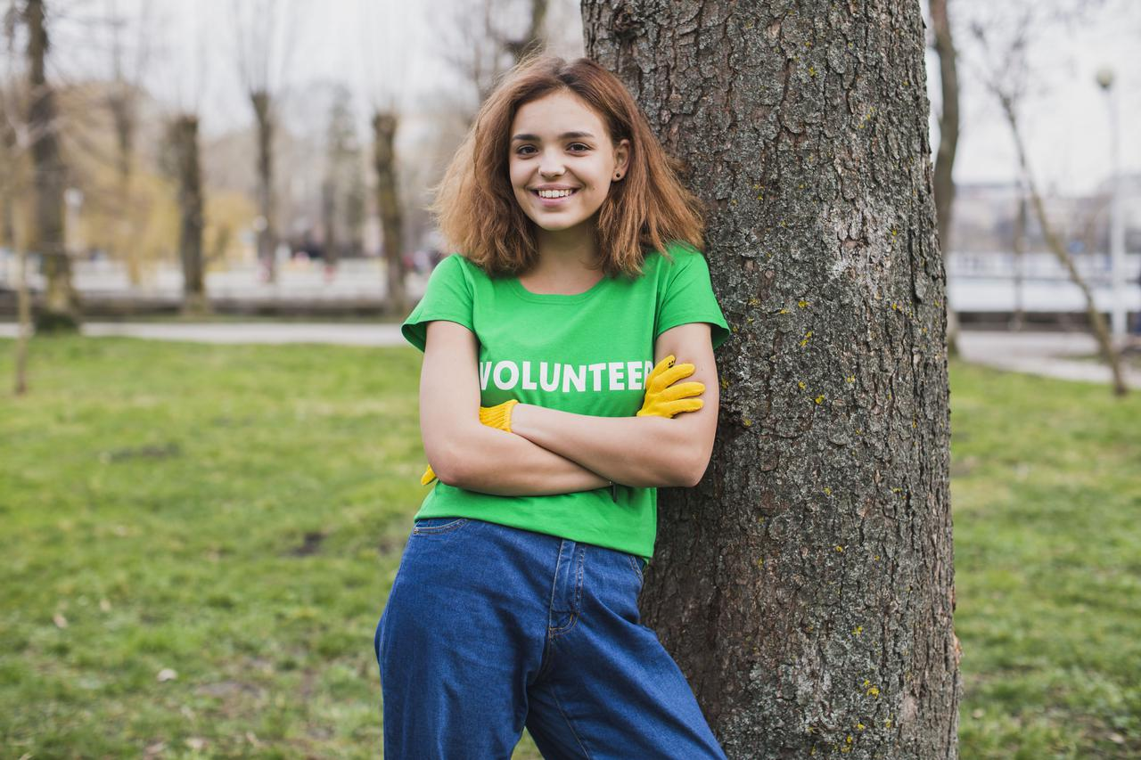 environment-volunteer-concept-with-woman-leaning-against-tree.jpg