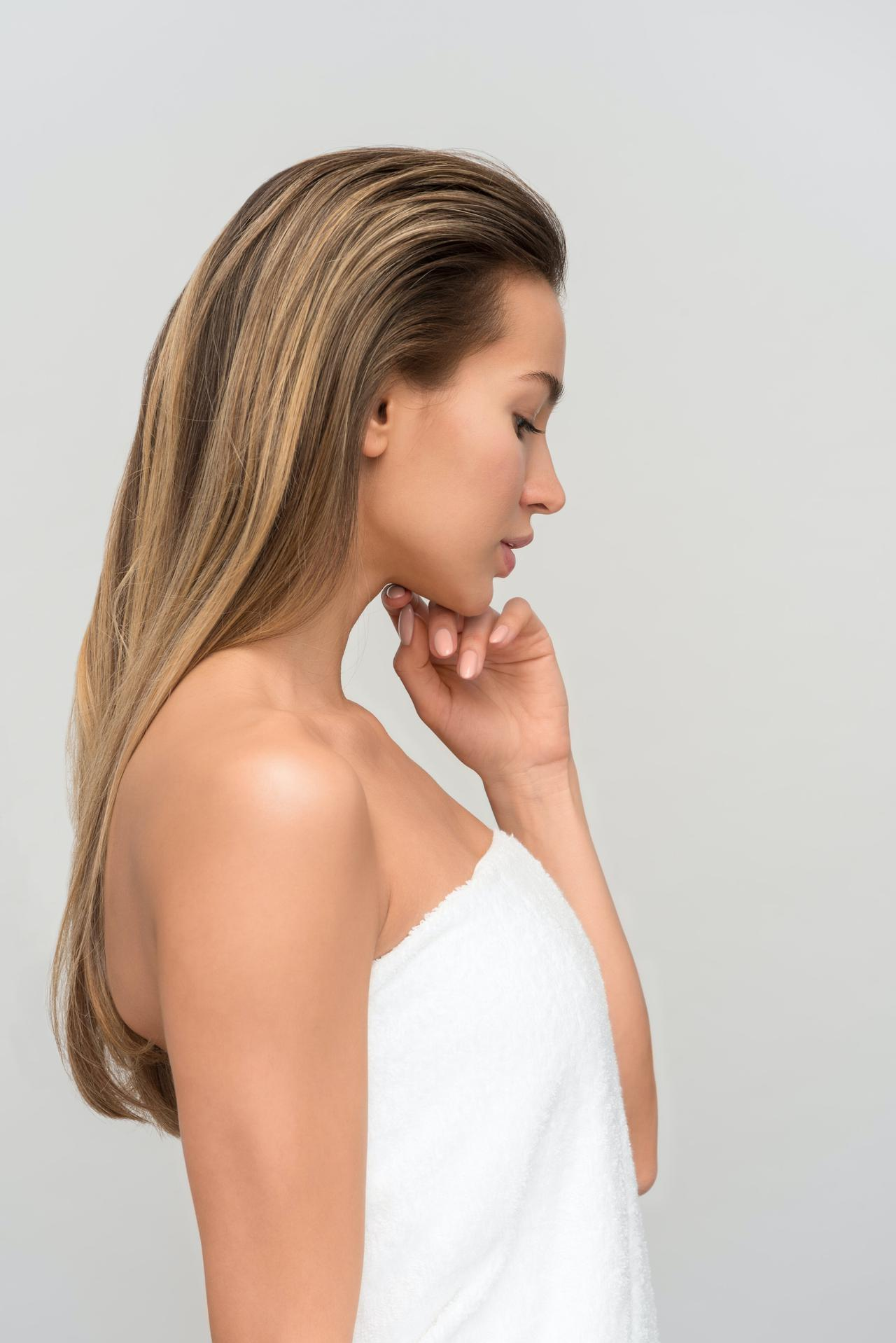 This is a picture of a woman wondering what questions to ask before starting your body shaping treatment.