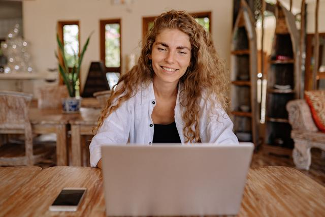 photo-of-woman-smiling-while-using-laptop-4458419.jpg