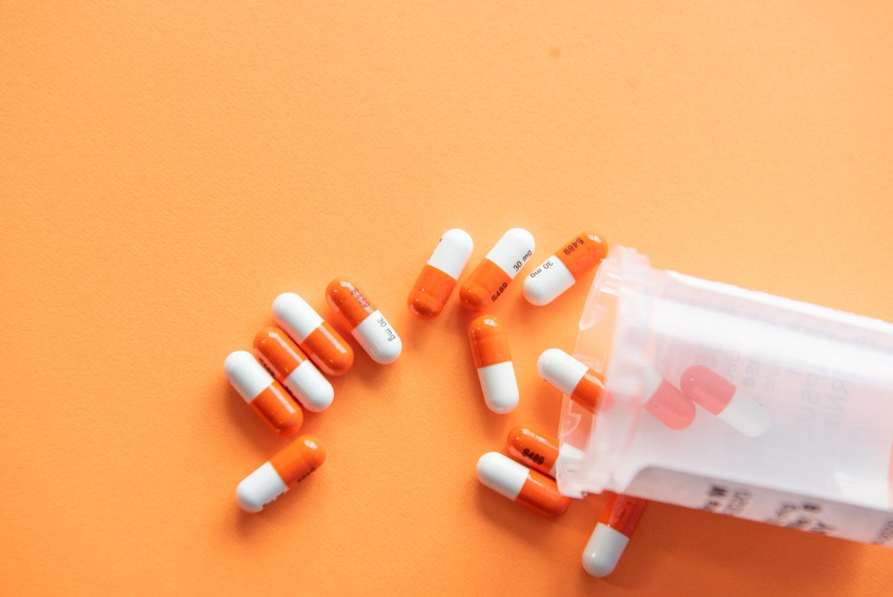 Prescription drugs with a pill bottle used to treat a UTI for however long the infection lasts.