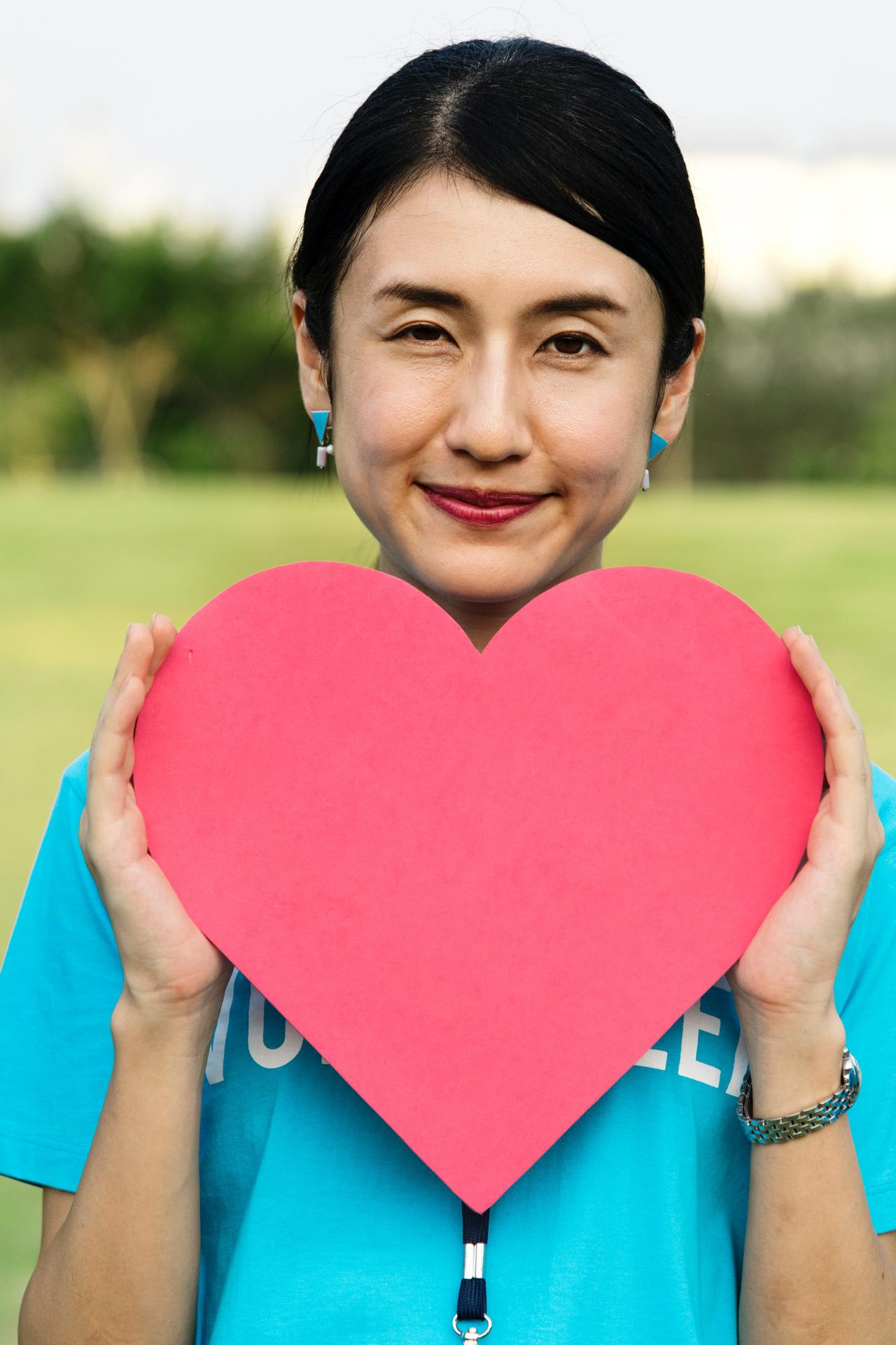 woman holding heart paper