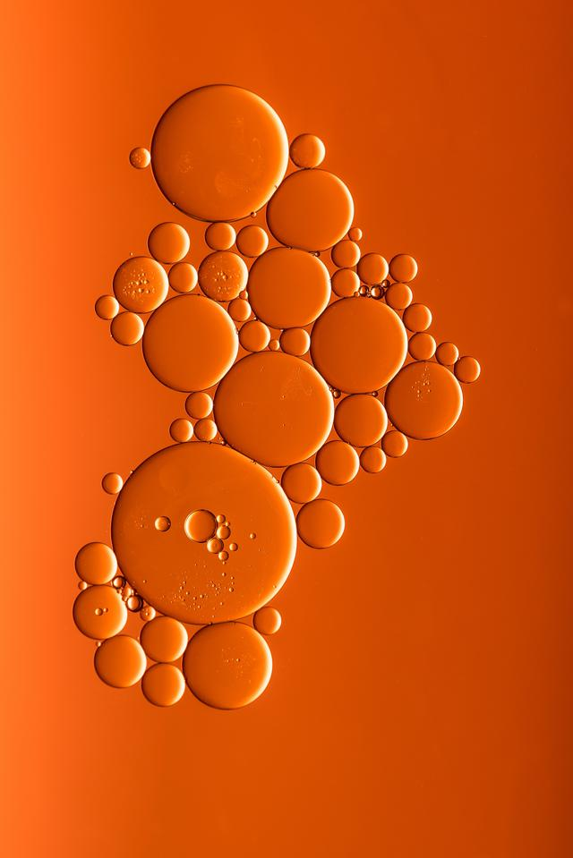 I dropped some oil into water with a spot of dish washing liquid in it, put some orange card underneath, added a bit of light, and there you have it! Easy as that.