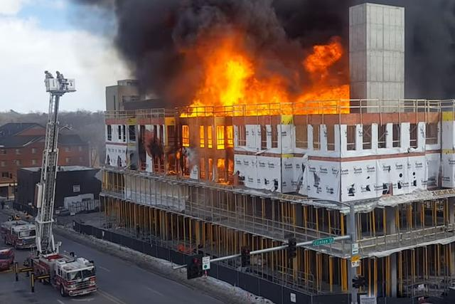 A building on fire. When filing a fire damage claim in Delaware, a private adjuster is crucial to ensure you get what you deserve.