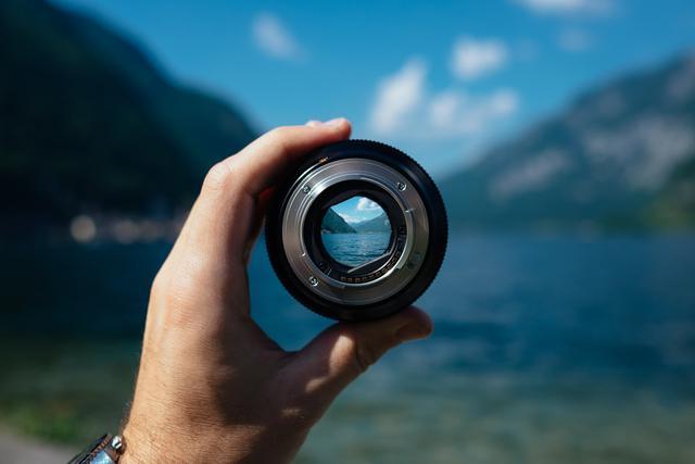 Mountain lake in camera lens