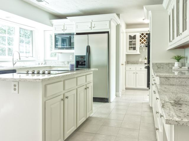 This is a picture of a kitchen with cabinets built by custom cabinet contractors.