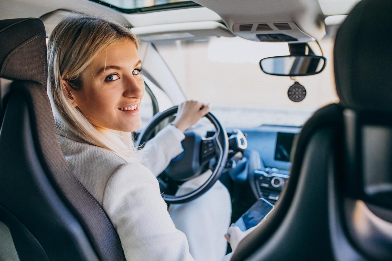 woman-sitting-inside-electro-car-while-charging.jpg