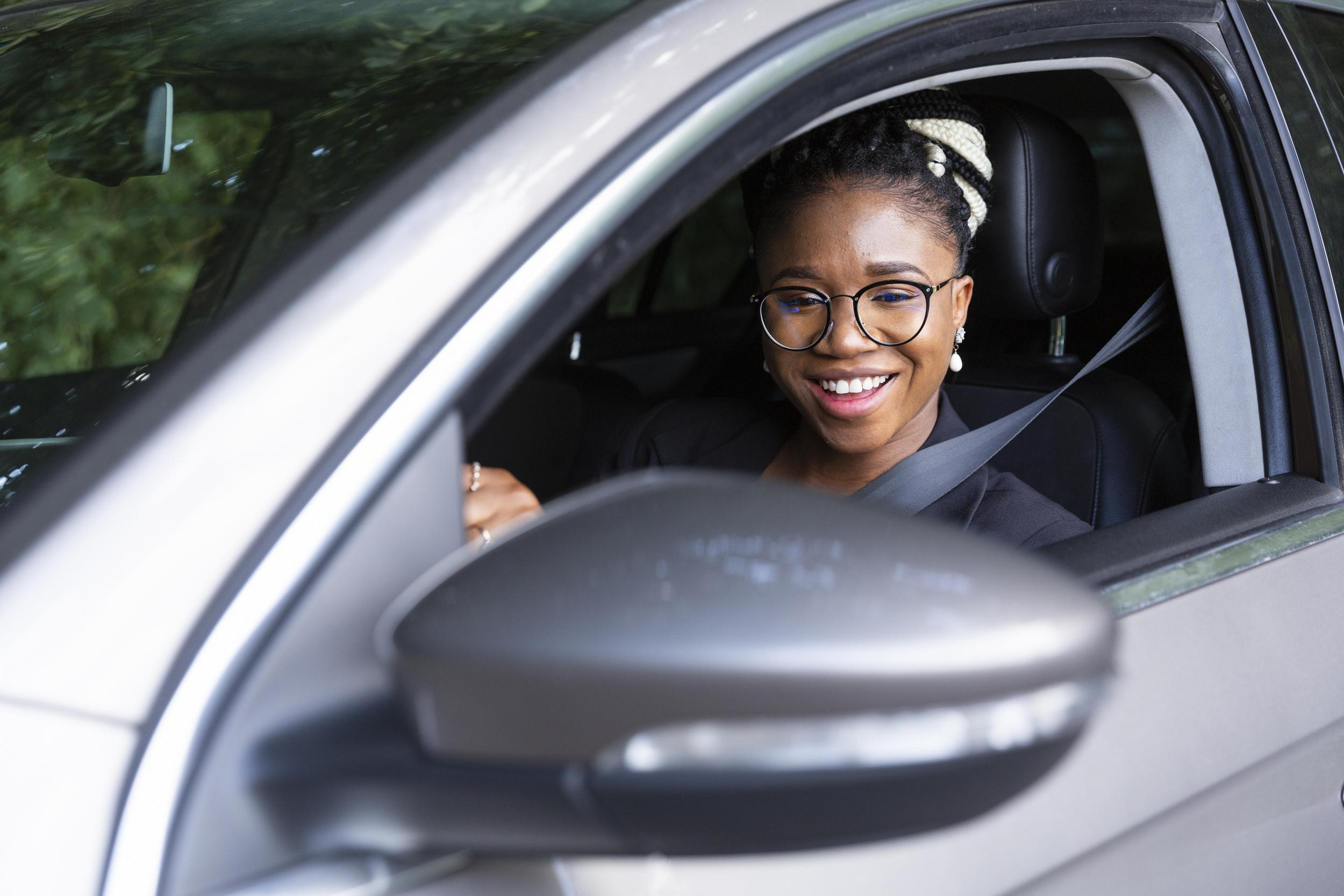 smiley-woman-driving-her-personal-car.jpg