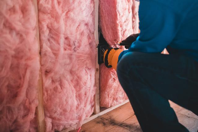 Installation of spray foam from air sealing services in St. Louis.
