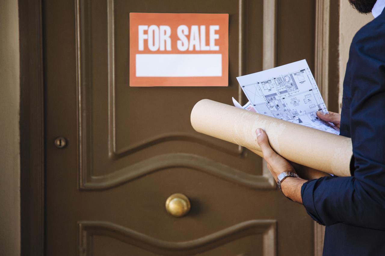 real-estate-agent-front-door-with-sale-sign.jpg
