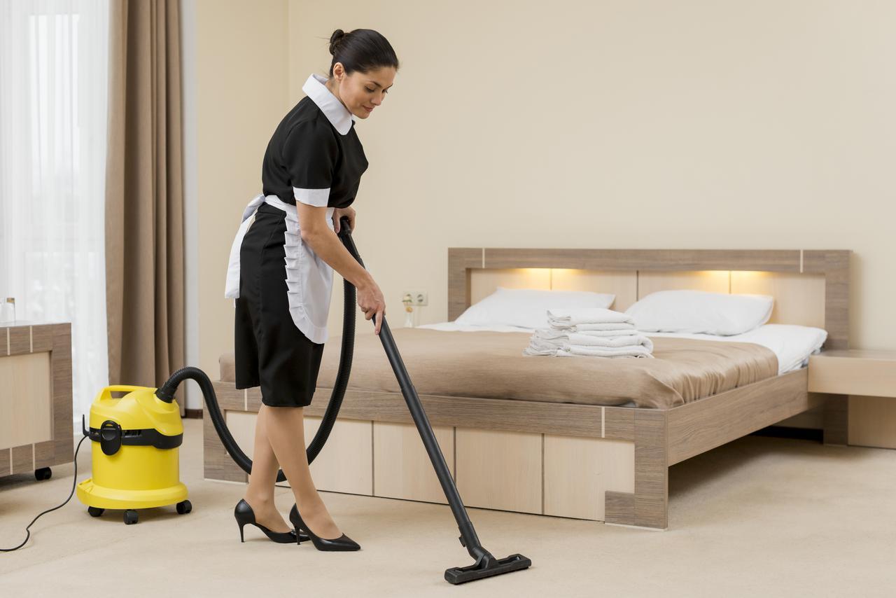 chambermaid-cleaning-hotel-room.jpeg