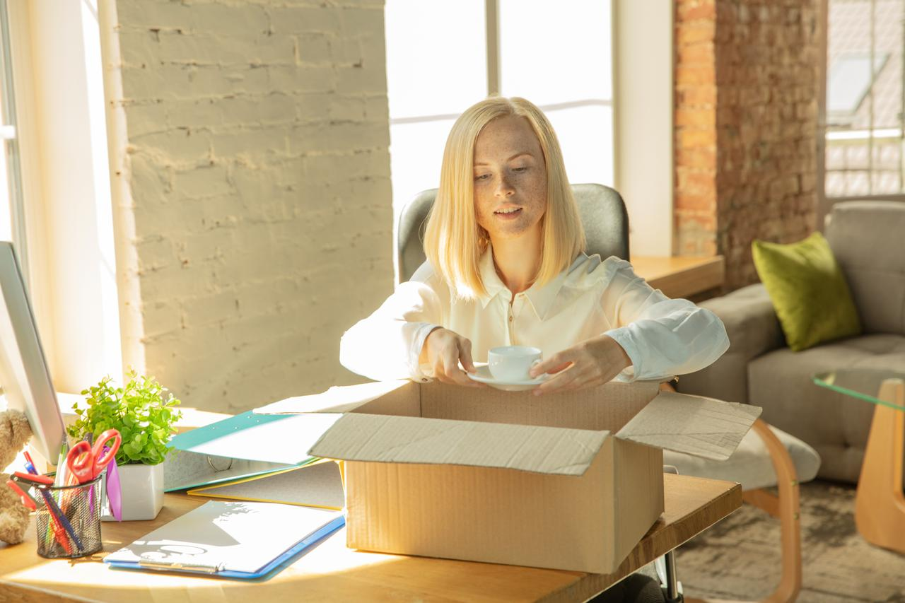 young-businesswoman-moving-office-getting-new-work-place-young-caucasian-female-office-worker-equips-new-cabinet-after-promotion.jpeg