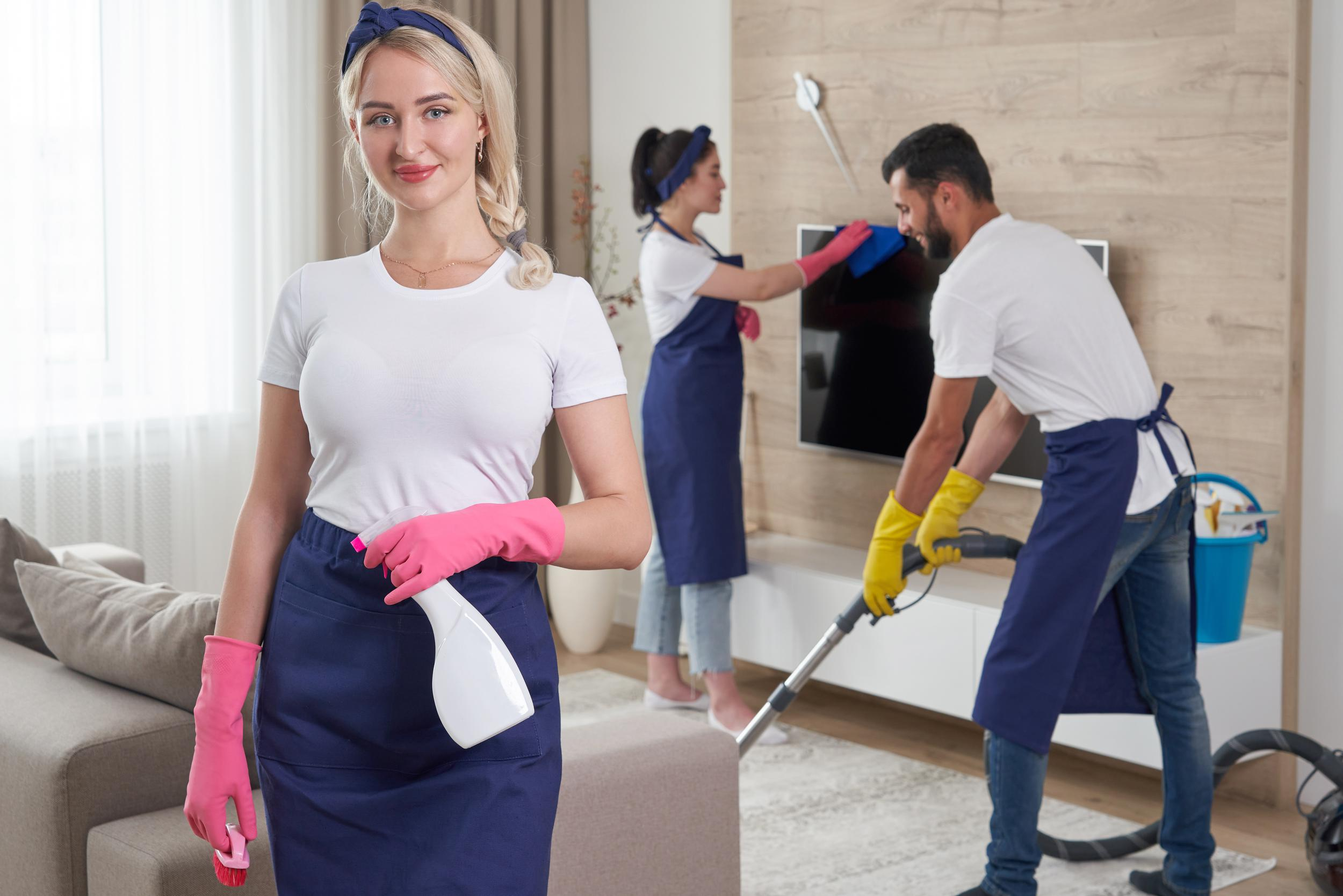 professional-cleaning-service-team-cleans-living-room-modern-apartment.jpg